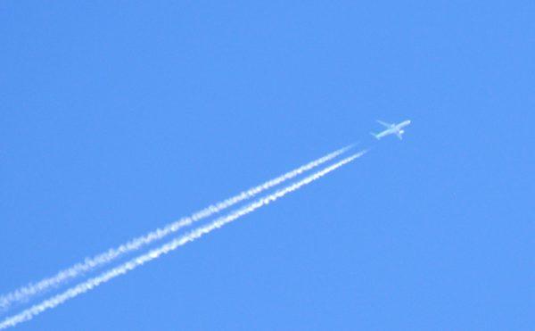 business IIdiom SMALL JET ON BLUE SKY