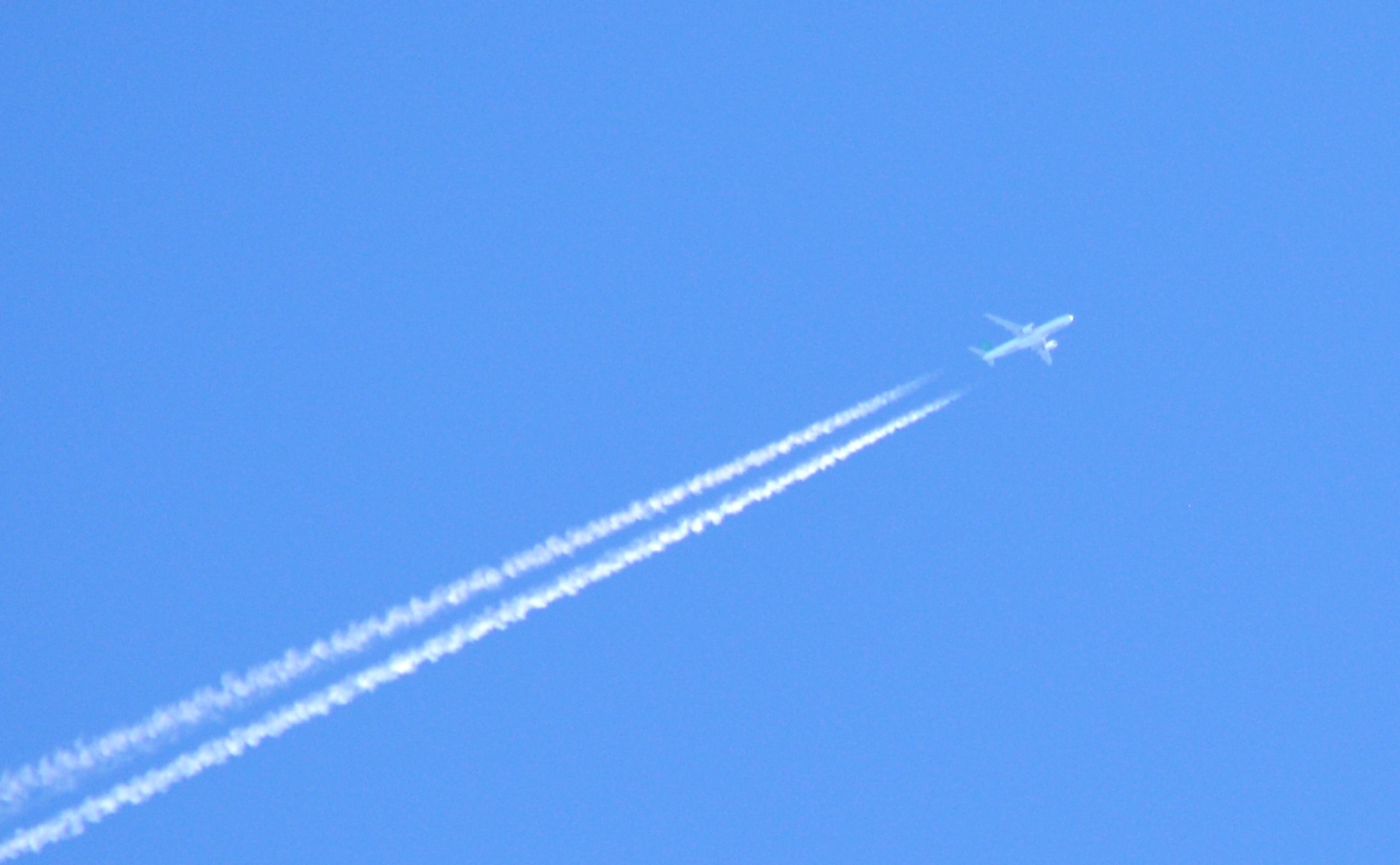 business IIdiom SMALL JET ON BLUE SKY